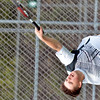 WARREN DILLAWAY / Star Beacon<br /> CLARK HEATH of Lakeside serves during second singles action with Geneva on Thursday at Lakeside.