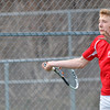 WARREN DILLAWAY / Star Beacon<br /> BROCK EBERSOLE of Geneva returns a shot during first singles action with Lakeside's Kyle Downs on Thursday at Lakeside.