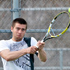 WARREN DILLAWAY / Star Beacon<br /> KYLE DOWNS of Lakeside returns a shot during first singles action with Geneva's Brock Ebersole on Thursday at Lakeside.