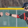 WARREN DILLAWAY / Star Beacon<br /> MATT BARBER fist bumps his father, and Jefferson head coach, after he was advanced to third base on Friday during a home  game with Lakeview.