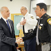 WARREN DILLAWAY / Star Beacon<br /> NICHOLAS IAROCCI (left), Ashtabula County prosecutor, shakes hands with Ashtabula County Sheriff William Johnson with Geneva Police Chief Dan Dudik (center) following a press conference announcing the  indictment of 23 Geneva area residents on drug charges.
