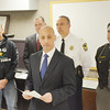 WARREN DILLAWAY / Star Beacon<br /> NICHOLAS IAROCCI (front with paper), Ashtabula County prosecutor addresses a press conference announcing the  indictment of 23 Geneva area residents on drug charges. (From left behind) Captain Jeff Orr of the TAG Law Enforcement Task Force; Dennis Sweet, Ohio Attorney General special agent in charge; Dan Dudik, Geneva police chief and Ashtabula County Sheriff William Johnson.