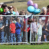 WARREN DILLAWAY / Star Beacon<br /> CHILDREN AND parents prepare to dash for eggs during the Geneva Easter Fest on Saturday at Memorial Field in Geneva.