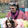 WARREN DILLAWAY / Star Beacon<br /> ROBERTA MARTIN of Erie places a head piece on Maria Mook, 7, of Ashtabula, during the Geneva Easter Fest on Saturday at Memorial Field in Geneva.
