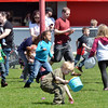 WARREN DILLAWAY / Star Beacon<br /> CHILDREN AND parents dash for eggs during the Geneva Easter Fest on Saturday at Memorial Field in Geneva.