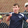 WARREN DILLAWAY / Star Beacon<br /> JOEY FERRANTE of St. John prepares to return a shot on Friday during a second singles match with Jacob Schauer of Madison.