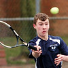 WARREN DILLAWAY / Star Beacon<br /> JOEY FERRANTE of St. John prepares to return a shot on Friday during a second singles match with Madison's Jacob Schauer.