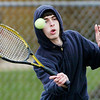 WARREN DILLAWAY / Star Beacon<br /> MATT PINELLI of St. John prepares to return a shot on Friday during a first singles match with Brandon Ortiz of Madison.