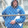 WARREN DILLAWAY / Star Beacon<br /> MARK VIDMAR, Madison boys tennis coach, tries to stay warm while watching his team play St. John on Friday at Madison.