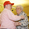 WARREN DILLAWAY / Star Beacon<br /> GARY HEAVEN hugs Mary Pepperney of the Hospice of the Western Reserve after he donated $5,000 to the organization during the Ashtabula County Board of Realtors Cake Auction at the Ashtabula Towne Square on Saturday.