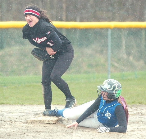 WARREN DILLAWAY / Star Beacon<br /> CAYCEE FUSCO (standing) of Jefferson grabs her arm after tagging Abby Thompson of Madison of out at third base on Saturday during the second gameof a double header at the Jefferson Area Girls Softball complex.