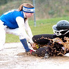 WARREN DILLAWAY / Star Beacon<br /> ARIAN BARILE of Jefferson slides safley into third base while Abby Thompson of Madison applies a late tag on Saturday during the second game of a double header at the Jefferson Area Girls Softball complex.