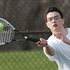 WARREN DILLAWAY / Star Beacon<br /> DIEGO MORENO of Grand River Academy returns a shot during a third singles match with Aaron Ball of Edgewood on Monday.