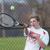 WARREN DILLAWAY / Star Beacon<br /> AARON BALL of Edgewood returns a shot during third singles action with Grand River Academy's Diego Moreno on Monday at Edgewood.