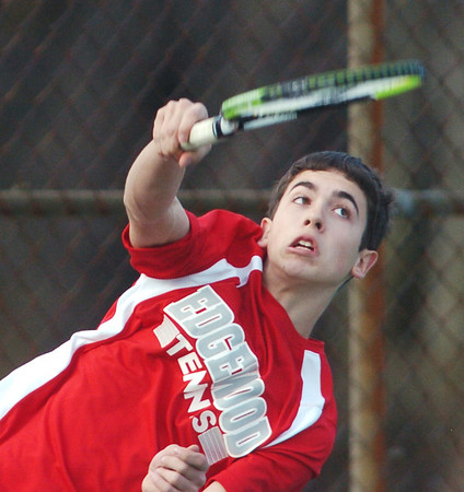 WARREN DILLAWAY / Star Beacon<br /> KEVIN MAURER of Edgewood follows through on a serve during first doubles action with Grand River Academy on Monday at Edgewood.
