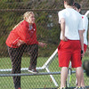 WARREN DILLAWAY / Star Beacon<br /> LESLIE DOUGLAS, Edgewood tennis coach, talks with her second doubles team, Maddie Smith (far right) and Dyland Bland (back to camera) on Monday during a home match with Grand River Academy.