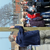 WARREN DILLAWAY / Star Beacon<br /> ROBY POTTS holds a cross during a Good Friday cross walk throughh downtown Ashtabula on Friday morning.