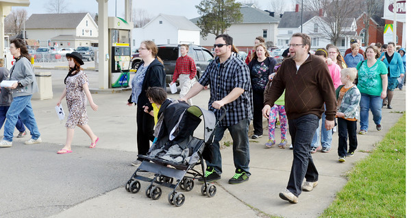 WARREN DILLAWAY / Star Beacon<br /> MORE THAN 85 people participated in the Pymatuning Valley Ministerial Association Community Good Friday Cross Walk in downtown Andover.