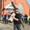WARREN DILLAWAY / Star Beacon<br /> SKYLER O'DONNELL carries a large wooden cross during the Pymatuning Valley Ministerial Association Community Good Friday Cross Walk in downtown Andover.