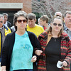 WARREN DILLAWAY / Star Beacon<br /> CRYSTAL LATIMER (left front) and Cheryl Ahlman, both of First Baptist Church in Ashtabula lead a group of people during a Good Friday cross walk in downtown Ashtabula.