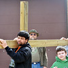 WARREN DILLAWAY / Star Beacon<br /> MORE THAN 35 people participate in a Good Friday cross walk through downtown Ashtabula on Friday morning. The Christians commemorated  the last moments of the life of Jesus Christ.