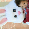 WARREN DILLAWAY / Star Beacon<br /> LANDIN WHITSON, 4, of Ashtabula hugs the Easter bunny during the Eggstravaganza event sponsored by the Ashtabula Downtown Development Association on Saturday at Lance Corporal Kevin Cornelius Park.