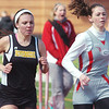 WARREN DILLAWAY / Star Beacon<br /> EMILY O'DELL (right) of Geneva and Taylr Strauss of Riverside battle for the lead of the 800 meters during the Perry Relays on Saturday.