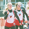WARREN DILLAWAY / Star Beacon<br /> DANA CROFOOT (left) and Perry teammate Morgan Hanno compete in the 100 meters on Saturday during the Perry Relays.