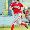 WARREN DILLAWAY / Star Beacon<br /> SAM BLASHINSKY of Edgewood rounds third and heads home to score a run on Monday during ahome game with Struthers.