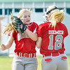 WARREN DILLAWAY / Star Beacon<br /> KATIE  CROOKS (left) and Edgewood teammate Taylor Diemer shoulder bump at the start of a home game with Struthers on Monday afternoon.