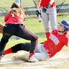 WARREN DILLAWAY / Star Beacon<br /> MERCEDES BURNS of Edgewood grimaces after sliding safely home under the tag of Alexa Bayus of Struthers on Monday during a game at Edgewood.