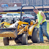 WARREN DILLAWAY / Star Beacon<br /> DAN JUHOLA works to get Smith Field ready for a baseball game today in Ashtabula.