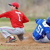 WARREN DILLAWAY / Star Beacon<br /> OWEN SILL of Madison (51) slides safely in to second base as Mitchell Dragon grabs the late throw on Tuesday afternoon at Edgewood.