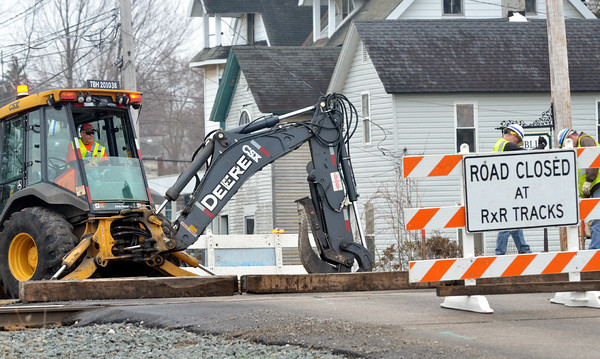 WARREN DILLAWAY / Star Beacon<br /> THE CSX Railroad tracks were closed along North Eagle Street in Geneva on Tuesday morning as crews worked on replacing rails.