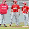 WARREN DILLAWAY / Star Beacon<br /> EDGEWOOD BASEBALL Coach Bill Lipps talks with Tony Magda (6) and Alex Newsome (14) while waiting for a Madison pitcher to complete his warmup on Tuesday afternoon at Edgewood.