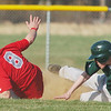 WARREN DILLAWAY / Star Beacon<br /> SETH BRYANT (right) of Lakeside slides safely into second base as Ryan Nappit of Geneva dives for the ball on Monday during a game at Geneva.