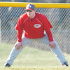 WARREN DILLAWAY / Star Beacon<br /> JUSTIN DRAPP, Geneva baseball coach, watches the action from the third base coaching box on Monday during a home game with Lakeside.