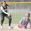 WARREN DILLAWAY / Star Beacon<br /> DEANGELA OLAVARRIA (left) of Lakeide prepares to apply a late tag to Geneva base runner Amy Pitcher on Monday afternoon at Geneva.