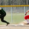 WARREN DILLAWAY / Star Beacon<br /> SARAH GEORGE, Lakeside third base man, reaches for the ball as Sydney McCaleb slides safely in to third base on Monday at Geneva.