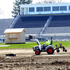 WARREN DILLAWAY / Star Beacon<br /> LANDSCAPING WORK is underway around the new track adjacent to the Conneaut High School football stadium. The track will be completed after the weather warms enough to allow the needed applications of rubber surface.