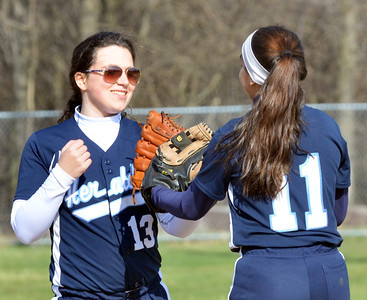 WARREN DILLAWAY / Star Beacon ALICIA NGIRAINGAS of St. John (right) is congratulated by teammate Maddie Martino during a Thursday afternoon game with Horizon Academy  at Massucci Field in Ashtabula.
