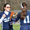 WARREN DILLAWAY / Star Beacon<br /> ALICIA NGIRAINGAS of St. John (right) is congratulated by teammate Maddie Martino during a Thursday afternoon game with Horizon Academy  at Massucci Field in Ashtabula.