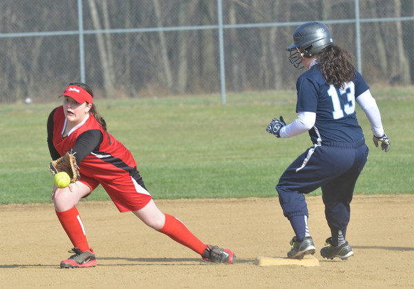 WARREN DILLAWAY / Star Beacon<br /> MADDIE MARTINO of St. John (13) arrives at second base as Tiffany Duperow of Horizon Academy awaits the throw on Thursday at Massucci Field in Ashtabula.