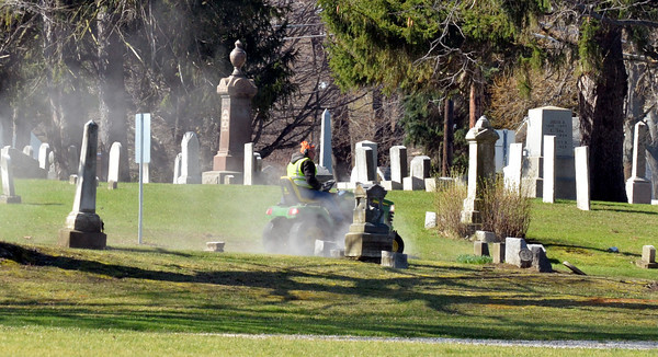 WARREN DILLAWAY / Star Beacon<br /> SLIGHTLY WARMER temperatures allowed Saybrook Township Cemetery workers the opportunity to mow the lawn on Thursday morning.