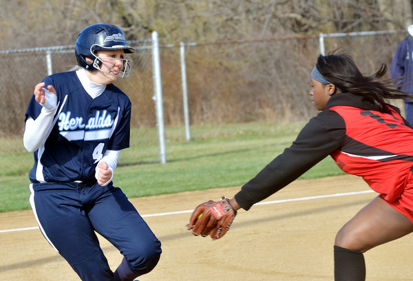 WARREN DILLAWAY / Star Beacon ALIVIA CIMMORELLI (4) of St. John tries to evade Maya Smith of Horizon Academy on Thursday at Massucci Field in Ashtabula.