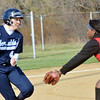 WARREN DILLAWAY / Star Beacon<br /> ALIVIA CIMMORELLI (4) of St. John tries to evade Maya Smith of Horizon Academy on Thursday at Massucci Field in Ashtabula.