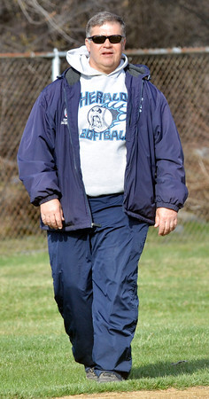 WARREN DILLAWAY / Star Beacon<br /> MIKE HOUSER, St. John softball coach, watches the action on Thursday during a home game with Horizon Academy at Massucci Field in Ashtabula.