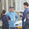 WARREN DILLAWAY / Star Beacon<br /> TODD NASSIEF, St. John tennis coach, instructs first doubles team Caroline Kovacs and Zac Cimorelli on Tuesday at Topky Courts in Ashtabula.