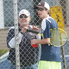 WARREN DILLAWAY / Star Beacon<br /> DAVE SIMPSON, Conneaut tennis coach talks with Scott Gerdes during a break in the action as the Spartans played St. John and Topky Courts in Ashtabula.