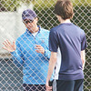WARREN DILLAWAY / Star Beacon<br /> TONY NASSIEF, St. John tennis coach, instructs first singles player Matt Pinelli on Tuesday at Topky Courts in Ashtabula.